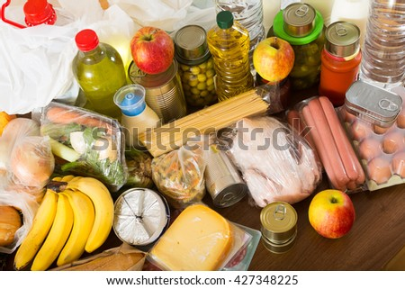food purchases from supermarket  on table - stock photo