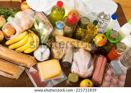 food purchases from supermarket  on table in home - stock photo