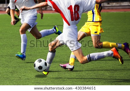football game at the stadium. Attack players - stock photo