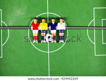 football players. foosball table soccer - stock photo