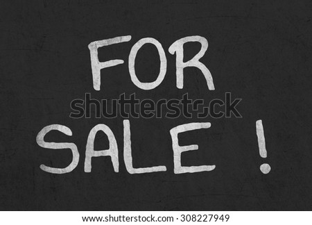 """for sale"" written on blackboard"