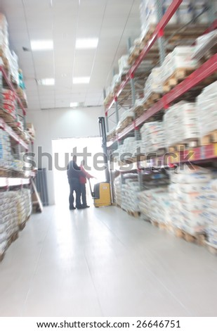 fork lifter work in big warehouse - stock photo