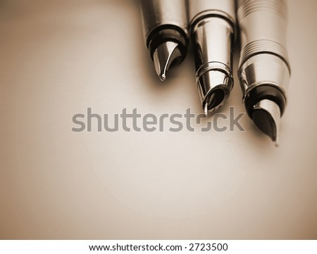 3 fountain pen isolated on brown.Great shoot.Great details - stock photo