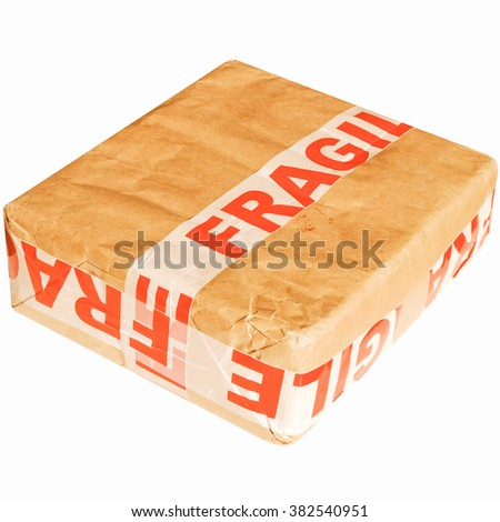 Fragile corrugated cardboard packet isolated on white vintage