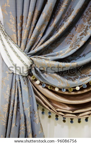 fragment of the beautiful curtains with fringe - stock photo