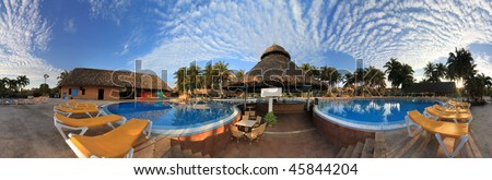 18 frame 360 degree panoramic of a beautiful resort at dawn. - stock photo