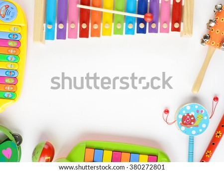 frame made of music accessories for children on white background - stock photo