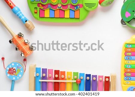 frame made of music accessories for children on white background. top view - stock photo