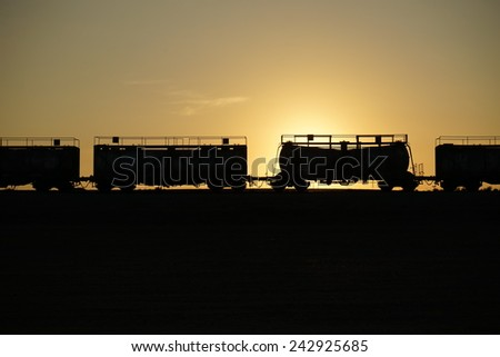 Freight cars and sunset on the rail road, Israel - stock photo