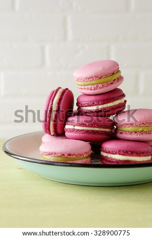 french macaroons on retro plate closeup - stock photo