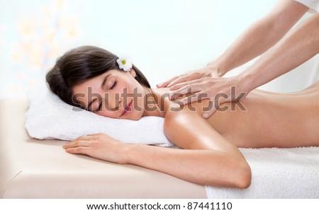 Fresh and Beautiful brunette woman getting a back massage - stock photo