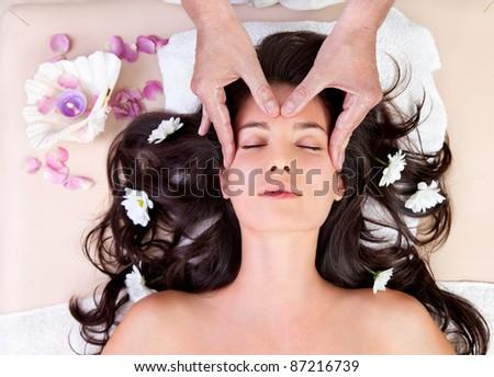 Fresh and Beautiful brunette woman having  head massage - stock photo