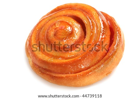 Fresh bake cinnamon roll with a cherry - stock photo