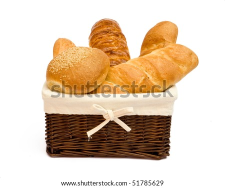 fresh bread rolls in a basket on whitete - stock photo