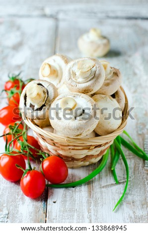 Fresh field mushrooms and tomatoes. Selective focus