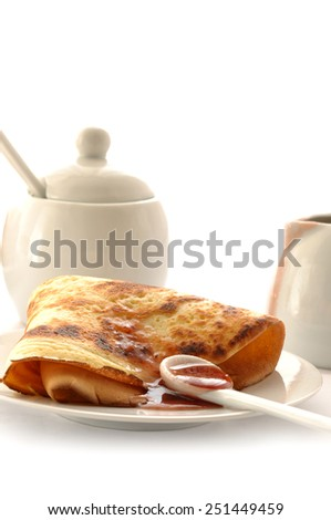 Fresh fried pancake with raspberry jam - stock photo