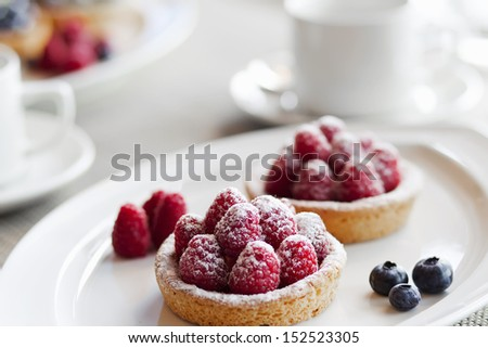 Fresh fruit pie tart with with raspberry on a plate - stock photo