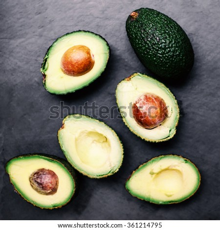 Fresh green avocado  over wooden table with copy space. Avocado Background top view image  - stock photo