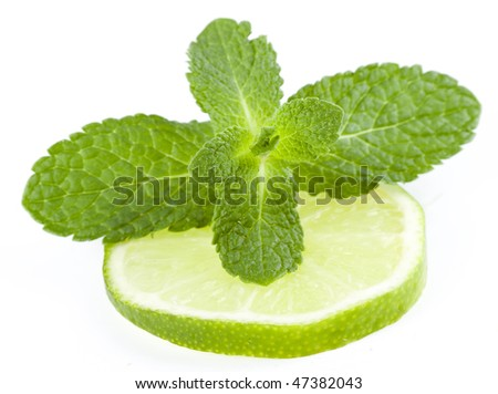 fresh limes and mint isolated on white - stock photo