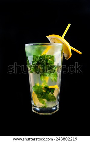 Fresh mojito isolated on black background. Ingredients: white rum, lime, mint, sugar and water