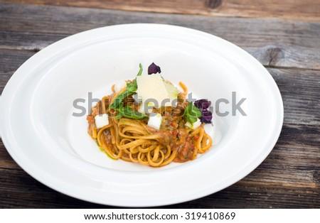 Fresh pasta with a tasty homemade siciliana  - stock photo