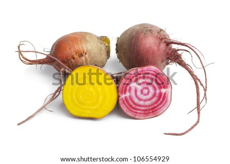 Fresh raw Chioggia beets and yellow beets on white background - stock photo