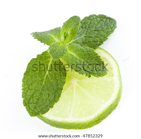fresh slice lime with leaf mint isolated on white - stock photo