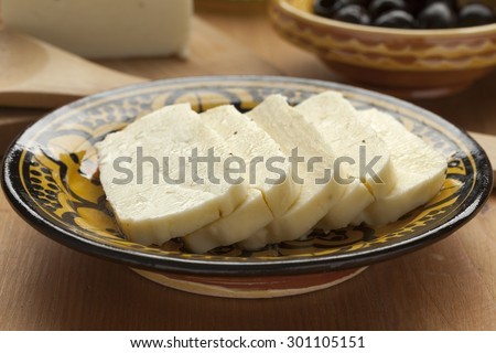 Fresh sliced halloumi on a bowl ready to cook - stock photo