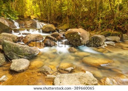 Fresh waterfall stream in the rainforest, Thailand. - stock photo