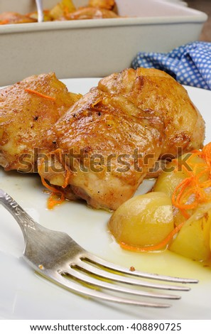 Fried chicken haunch  with boiled potatoes and carrots on a plate