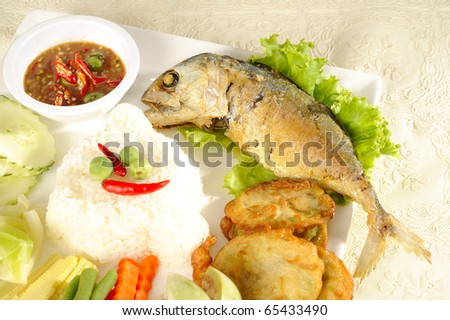 fried mackerel with thai hot and spicy seafood sauce mixed herb and rice-thai cuisine-namprik pla tu