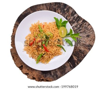 Fried noodle topped with pork, chicken, etc. - stock photo