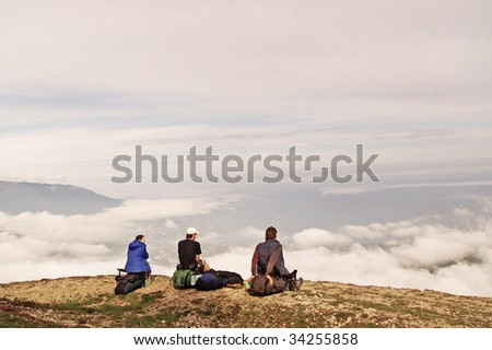 3 friends above the clouds - stock photo