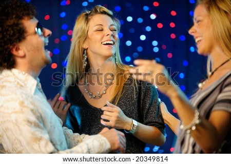 friends partying in night club - stock photo