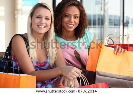 2 friends shopping - stock photo