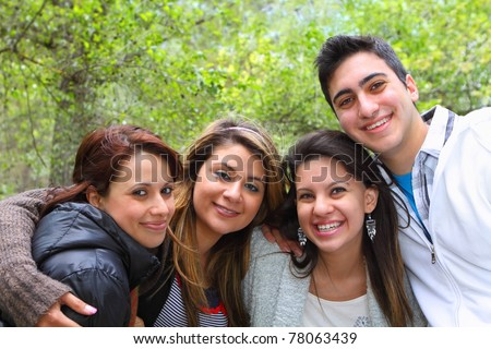4 Friends Smiling Together - stock photo