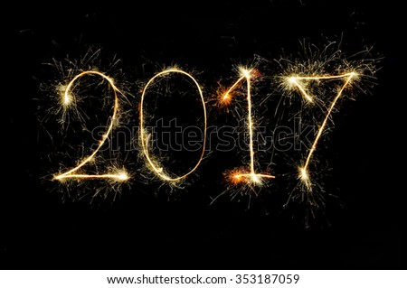 2017 from sparkler on black background - stock photo