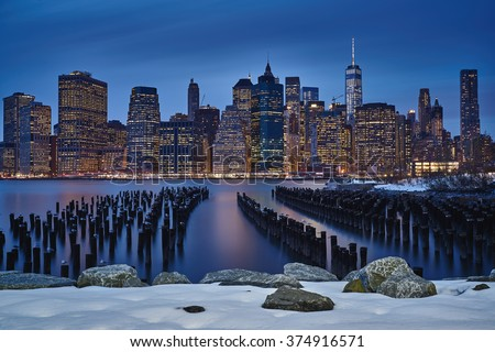 Frozen Metropolis, View of Manhattan from Brooklyn with snow  - stock photo