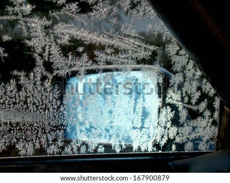 frozen rear-view mirror - stock photo