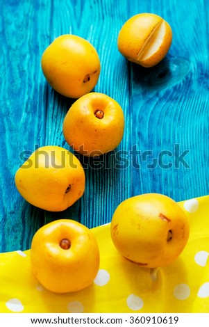 fruit, fresh ripe yellow quince on a contrasting wooden background - stock photo