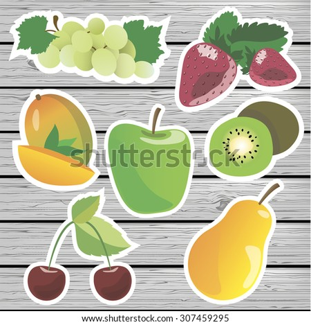 fruit labels on a wooden background.  fruit stickers.  stickers grapes, strawberry, mango, kiwi, apples, pears, cherries. - stock photo
