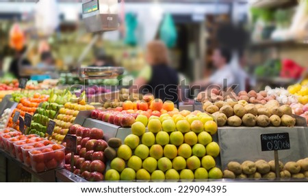 Fruits and vegetables on european market counter - stock photo
