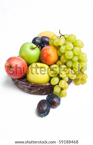Fruits placed in a wicker basket isolated on white background - stock photo