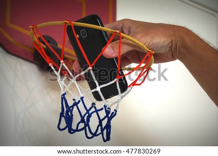 frustrated costumer slam dunking phone through child's basketball hoop