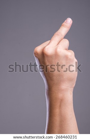 """""""Fuck you"""" sign by hand - stock photo"""