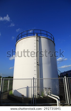 fuel storage tank against blue sky
