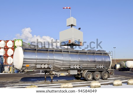 Fuel Tanker Truck in front of container warehouse - stock photo