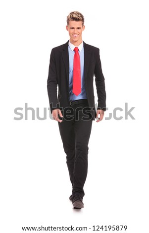 full body picture of a walking businessman isolated over a white background