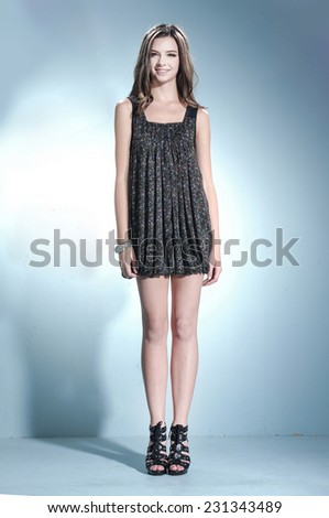 full length beautiful casual young fashion model shot in studio - stock photo
