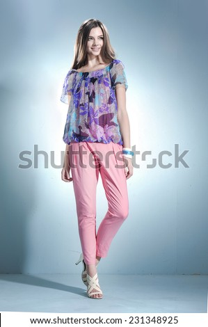 full length beautiful casual young fashion model walking - stock photo